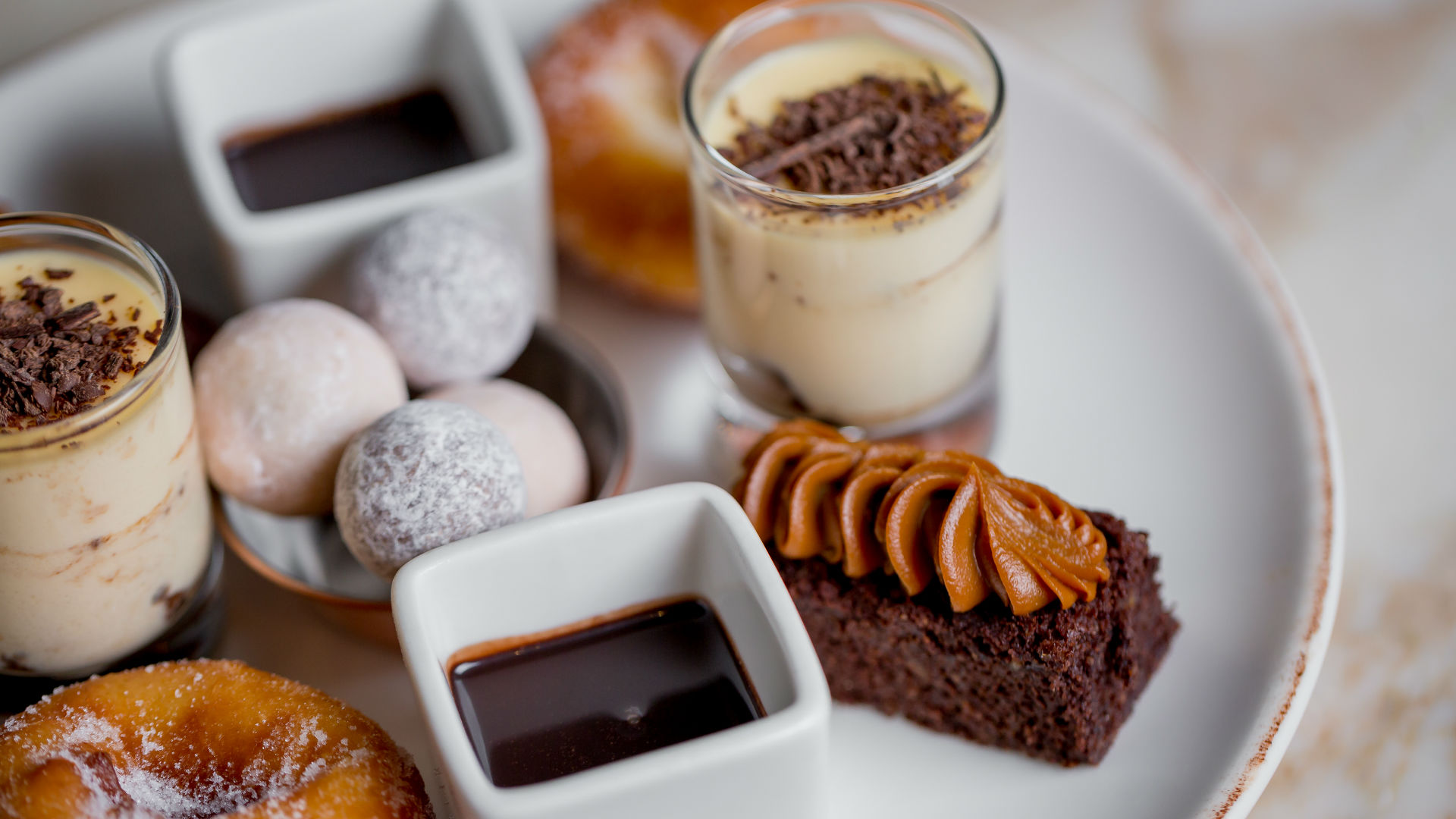 Chocolate cakes and other sweet treats in May Fair Kitchen's Charbonnel et Walker afternoon tea. Image courtesy of May Fair Kitchen. Photo: Justin de Souza