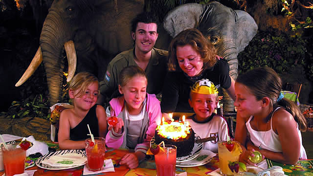 Rainforest Cafe family birthday party with a cake and candles. Image courtesy of Rainforest Cafe.