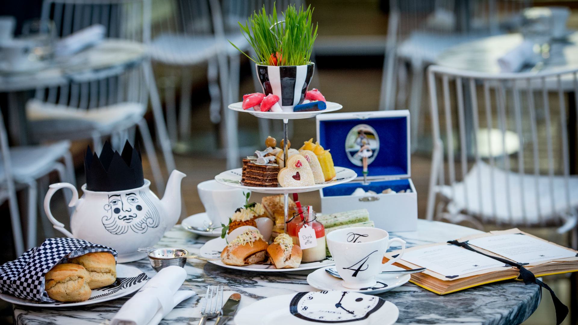 Scones, cakes and sandwiches in the Mad Hatter's Afternoon Tea at Sanderson. Image courtesy of Sanderson