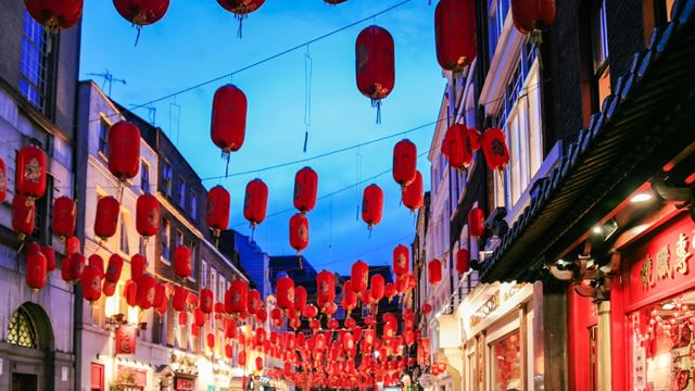 Red and bright Chinese lanners at night-time in Chinatown in London.