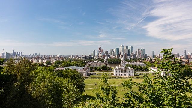 The view from Greenwich Park featuring the Old Royal Naval College and Canary Wharf.