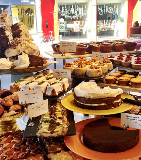 Window display of cakes and pastries at Ottolenghi in  Islington