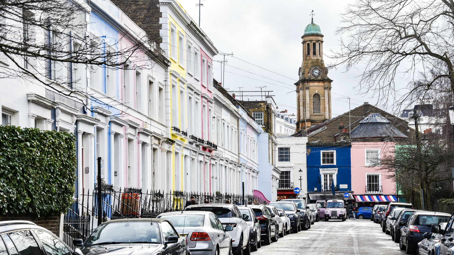 A view along one of Notting Hill's pretty streets with pastel-coloured houses
