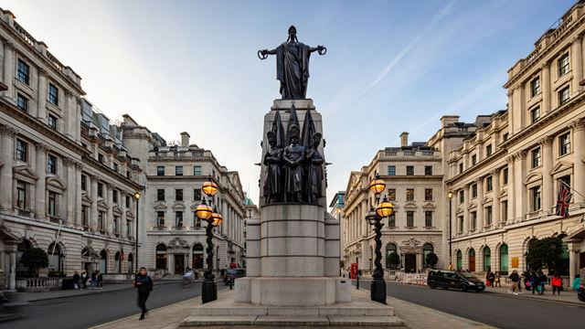Looking along Waterloo Place on a clear day, with the Guards Crimean War Memorial in the foreground.