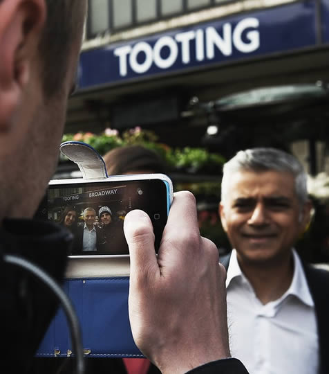 Man takes photo of Mayor Sadiq Khan outside Tooting Tube station