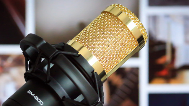 A gold microphone for singing karaoke