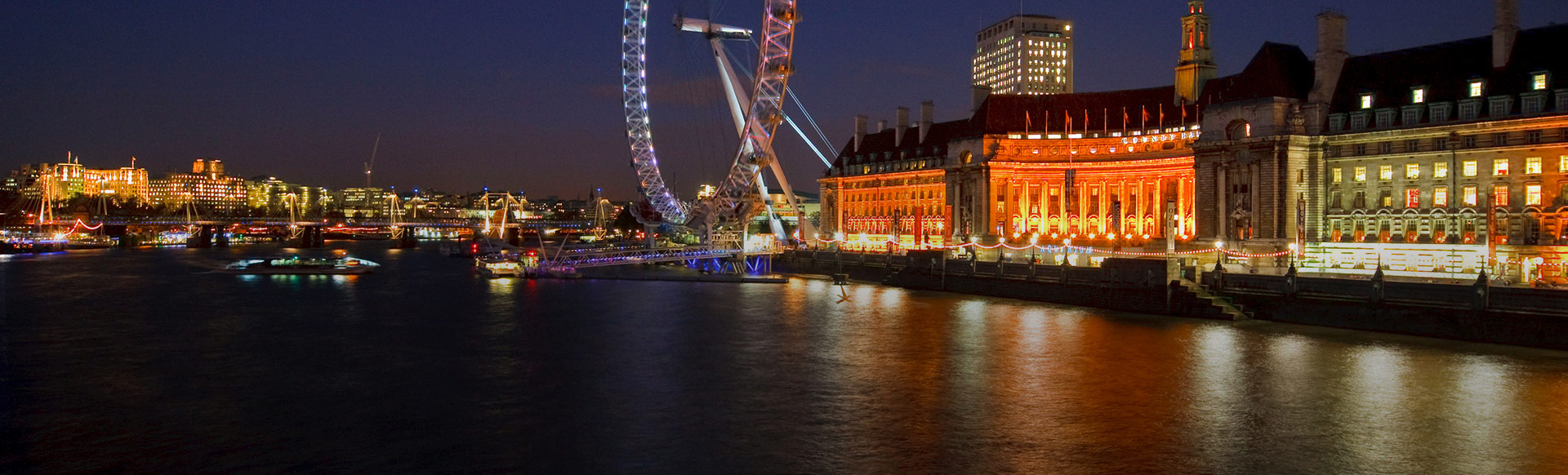 A night view of river Thames and Coca-Cola London Eye. © London and Partners/Pawel Libera