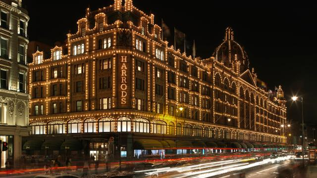 Harrods department store lit up at night