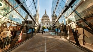 A view towards St Paul's Cathedral taken between two reflective glass walls at One New Change.