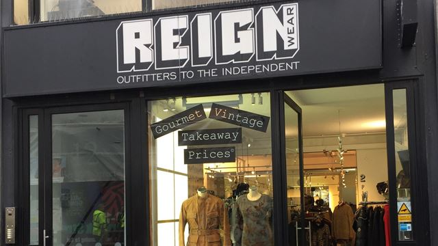 shop front featuring two manequins at Reign vintage clothing shop