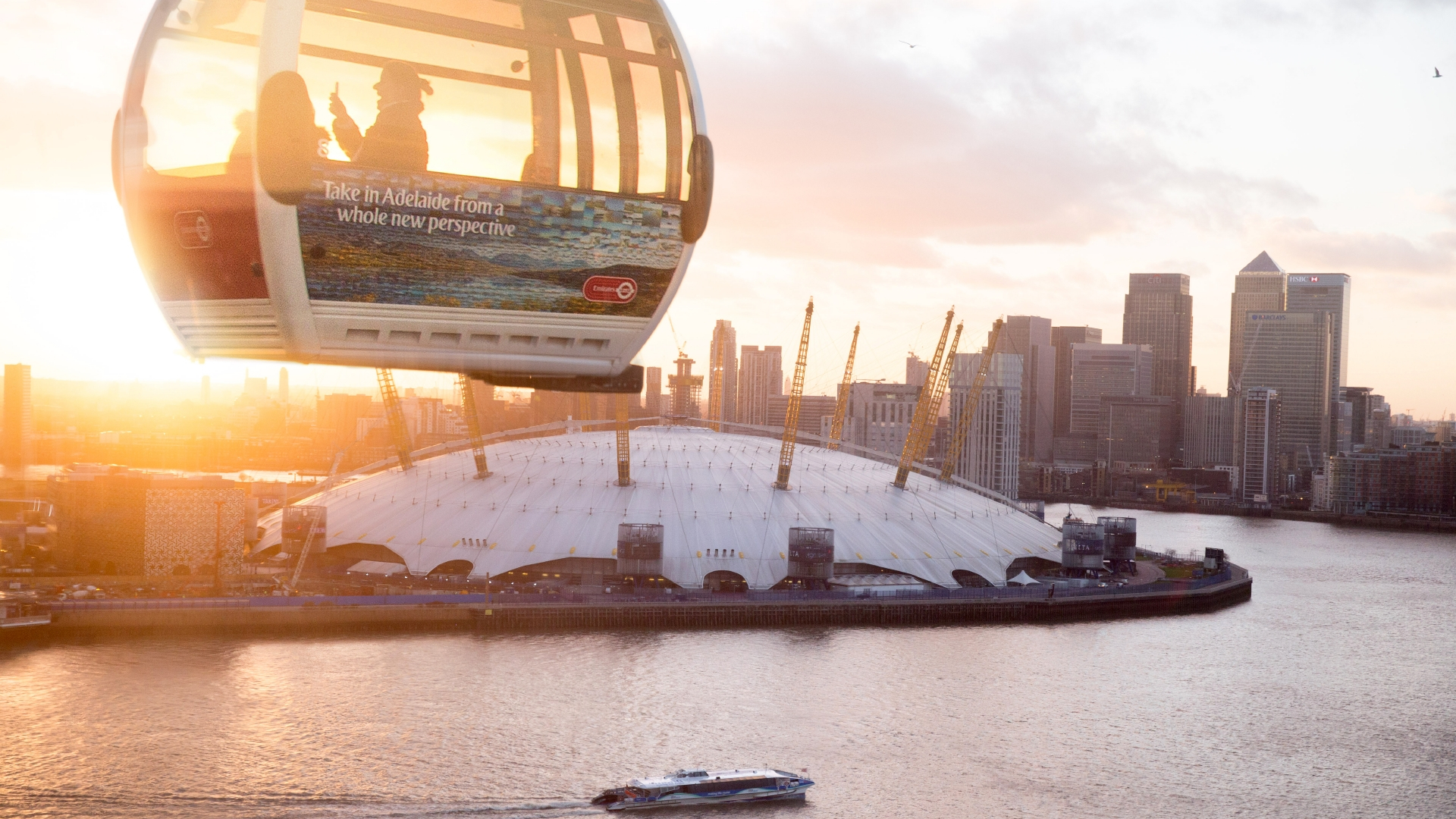 Emirates cable car flying over the river Thames and The O2.