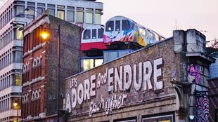 Street art and tube train offices in Shoreditch.
