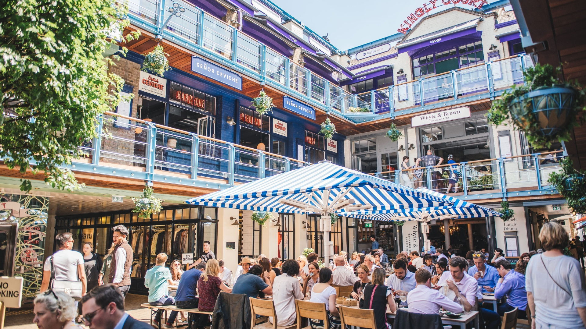 People eating out in London's Kingly Court in summer.