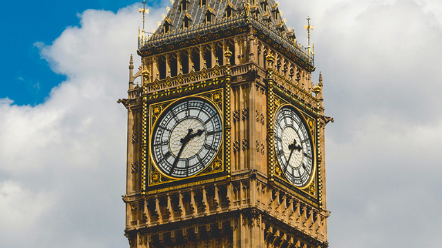 The clock faces of Big Ben on a sunny day