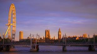London sunrise over the river Thames with the London Eye and Big Ben in the distance.