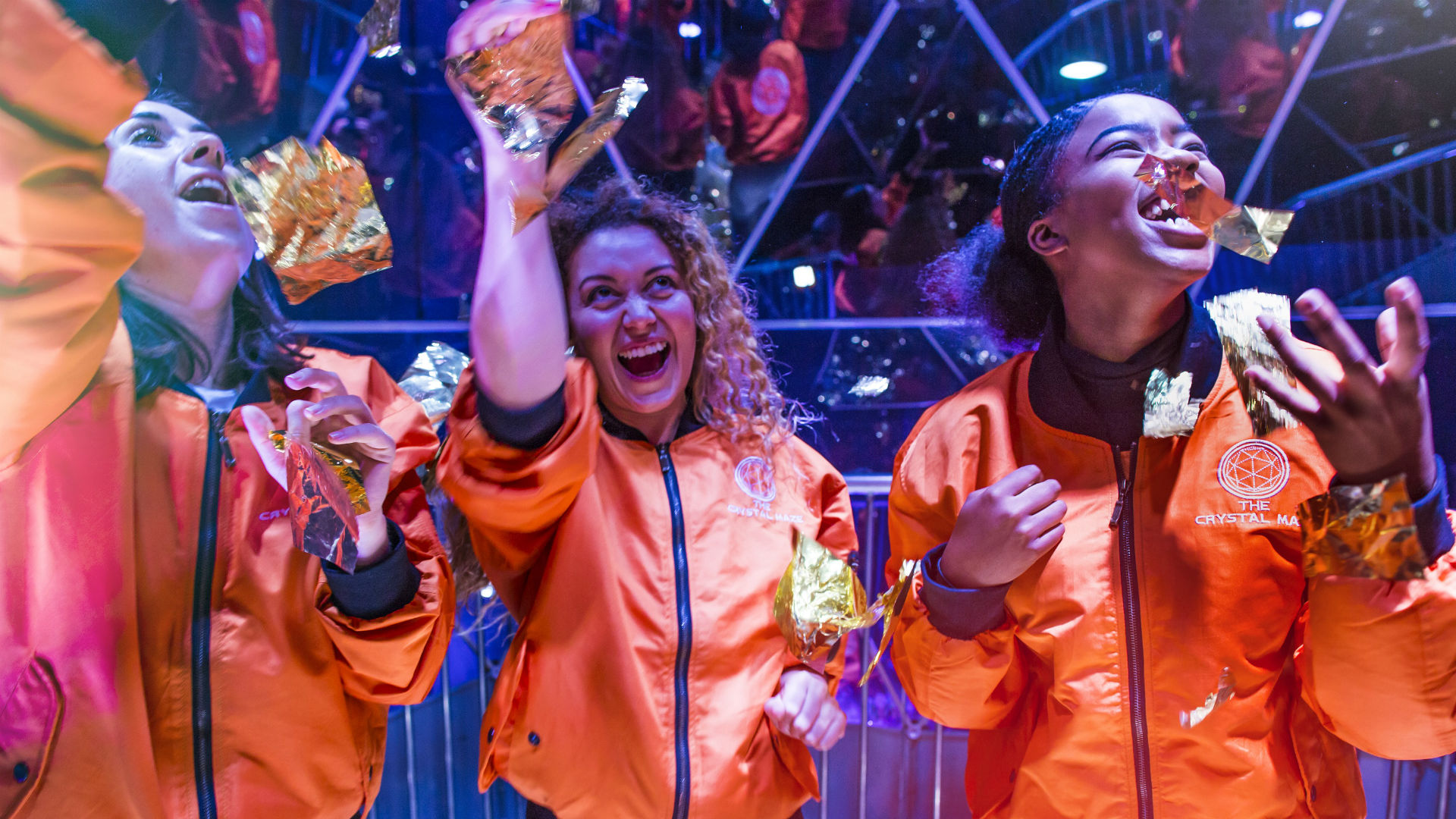 Three people enjoying The Crystal Maze experience