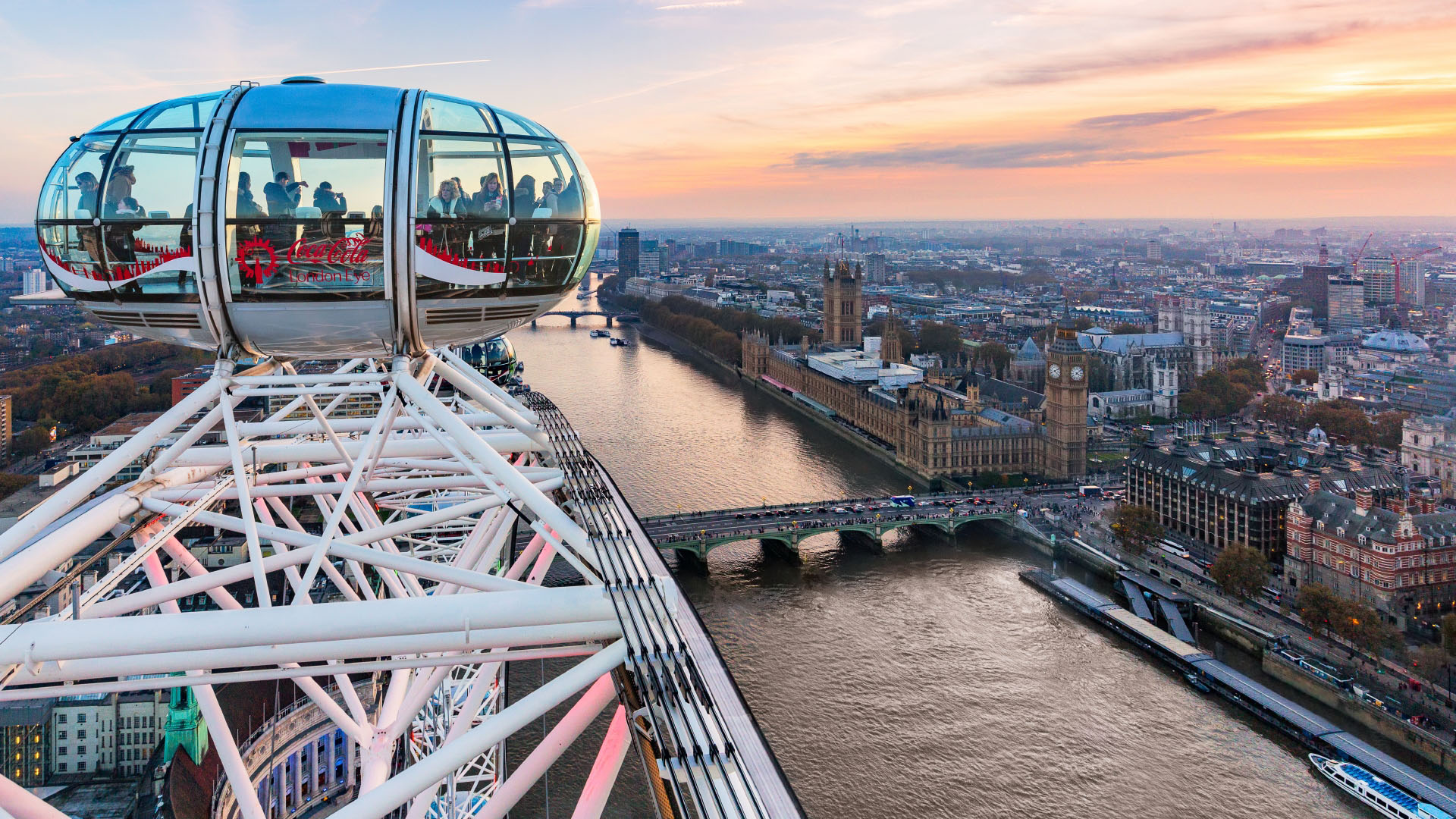 View of London including the Thames and Big Ben from the London Eye with a capsule in the foreground.