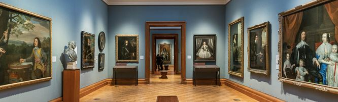Interior of the National Portrait Gallery with paintings and sculptures.