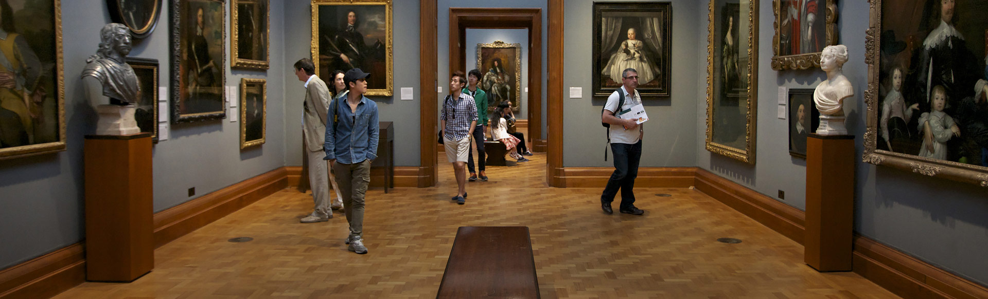 Interior of the National Portrait Gallery with people looking at paintings and sculptures. © London and Partners/Pawel Libera