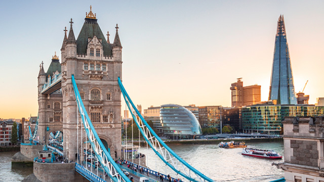 A view across the river Thames, including Tower Bridge, City Hall and The Shard on a bright day.