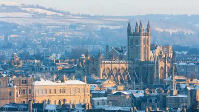 Photo of the city of Bath skyline on a winter day, with prominent Bath Abbey.