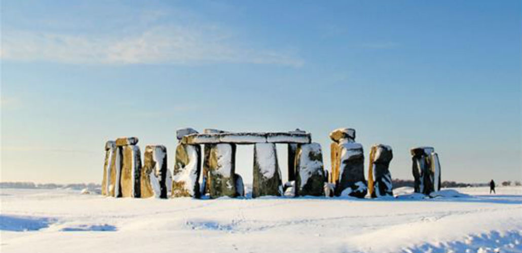 A photo of Stonehenge site covered in snow.