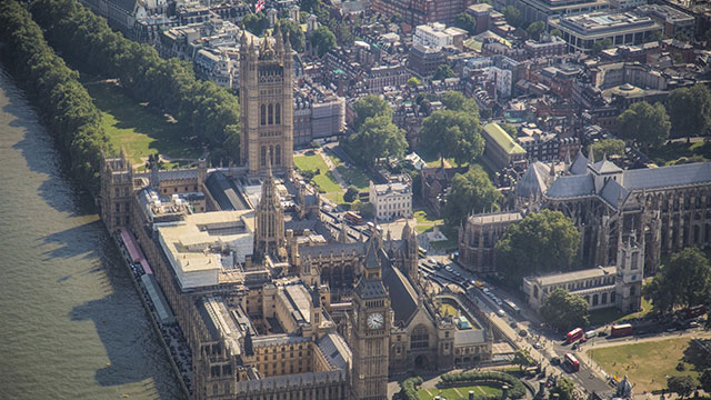 Aerial views of Westminster, Big Ben and the Houses of Parliament from a helicopter
