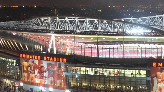 The Arsenal Emirates football stadium lit up a night for a match