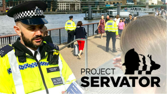 London police office in uniform beside the river Thames speaking to a lady with the words Project Servator in the corner of the image