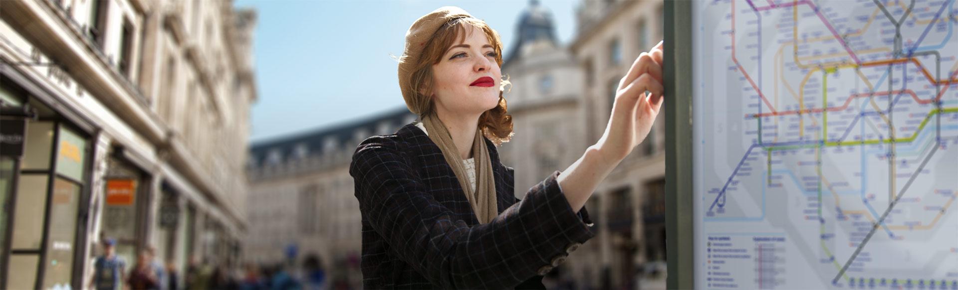 Woman reading a map in Regent Street