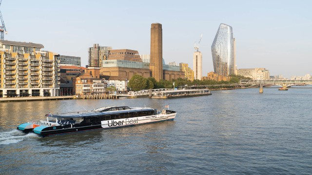 The Jupiter clipper operated by Uber Boat by Thames Clippers sails past Bankside.
