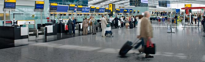 People checking in at London Heathrow Airport