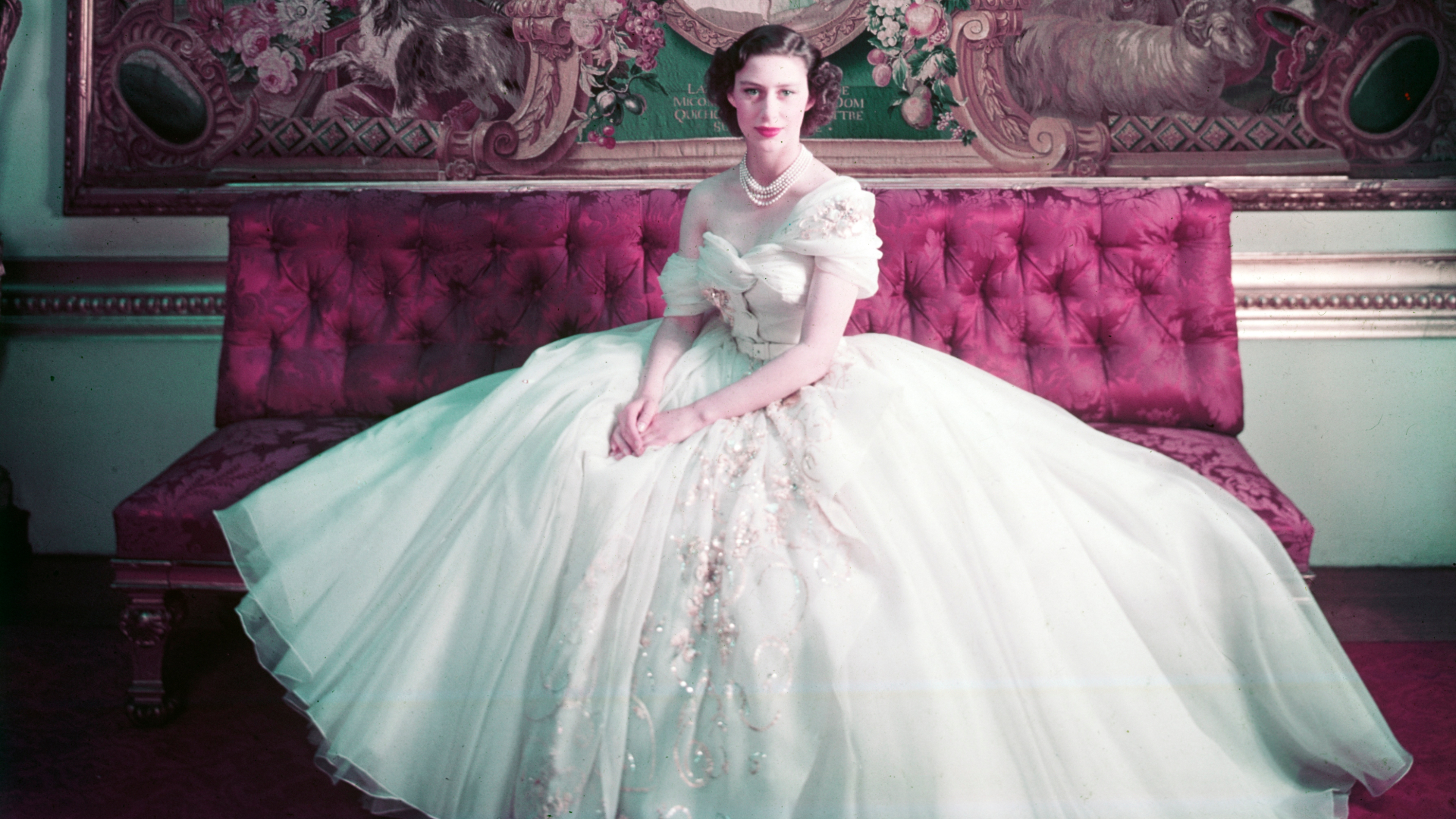 Photograph of Princess Margaret wearing a white Dior gown as part of the Christian Dior: Designer of Dreams exhibition at the V&A