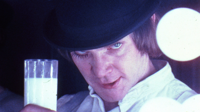 Still of a man holding a glass of milk from the film A Clockwork Orange as part of Stanley Kubrick: The Exhibition at the Design Museum