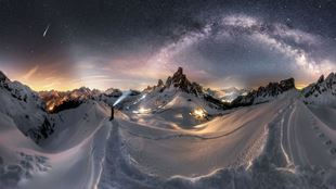 The Milky Way stretching over the snow-covered Dolomites at night, captured by Nicolai Brügger, as part of the Insight Astronomer of the Year exhibition at the NMM