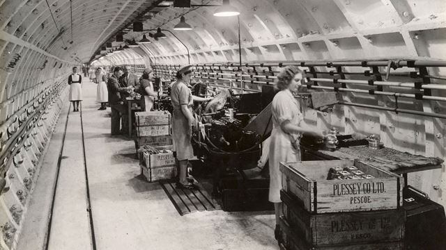 Factory workers at Plessey, 1941, as part of Hidden London: the Exhibition at the London Transport Museum