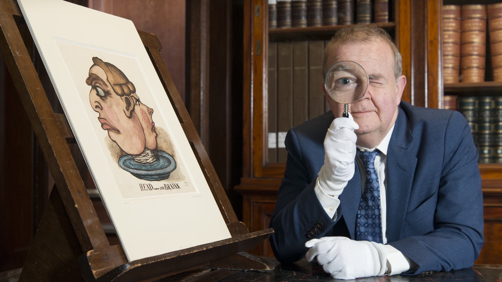 Ian Hislop at the British Museum with magnifiying glass
