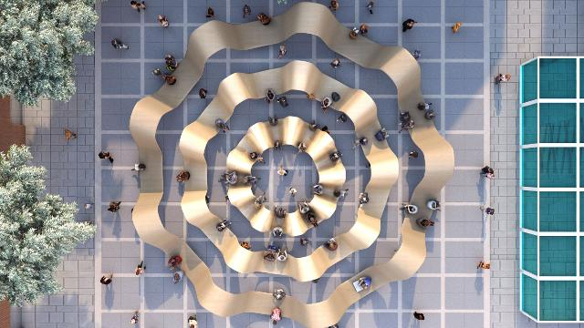 An aerial view from above of Please Be Seated by Paul Cocksedge, which is made up of three concentric gold-coloured circles.