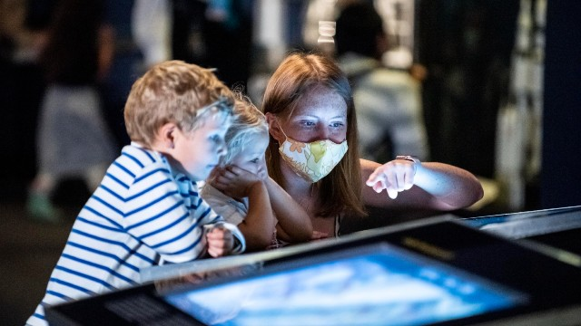 Visitors engaging with interactive exhibits in the Exploring Space Gallery at the Science Museum © Science Museum Group