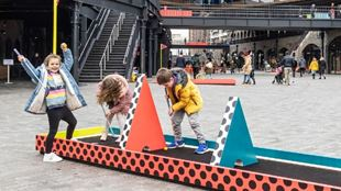 Kids playing mini golf in the middle of King's Cross.