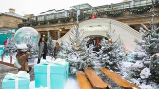 Giant presents, benches and Christmas trees covered in fake snow at the Covent Garden Tiffany & Co. Winter Wonderland.