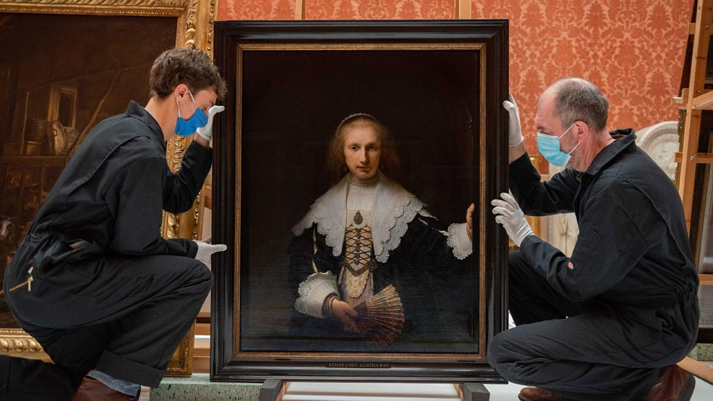 Royal Collection Trust staff prepare to move Rembrandt van Rijn's Portrait of Agatha Bas ('Lady with a Fan'), 1641, to The Queen's Gallery for the exhibition Masterpieces from Buckingham Palace.