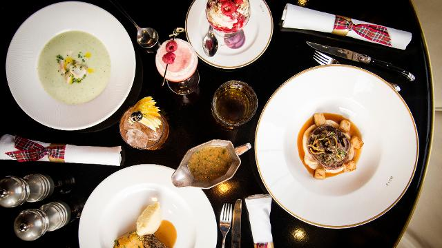 Plates and saucers with traditional Burns Night dinner delicacies on at Plum + Spilt Milk.