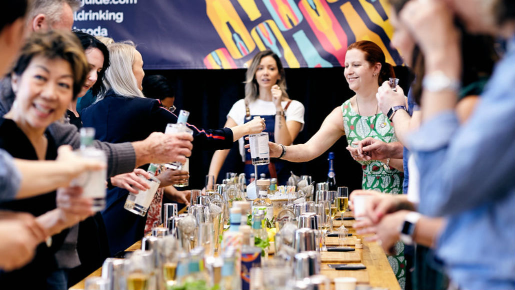 People drinking and cheering at a long table during The Club Soda Mindful Drinking Festival 2020.