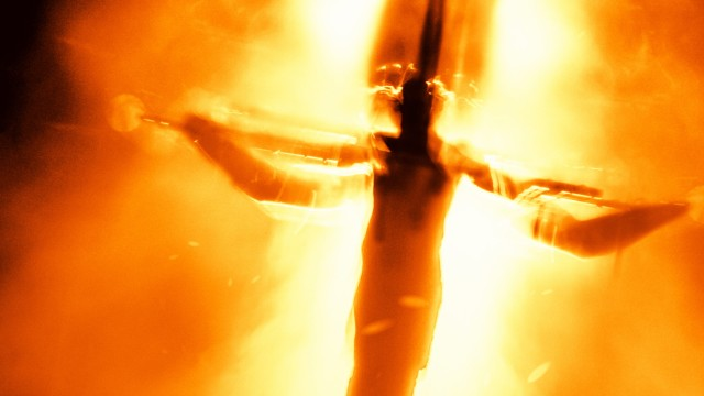 Blurry image of Jesus on the cross during a stage performance of Jesus Christ Superstar.