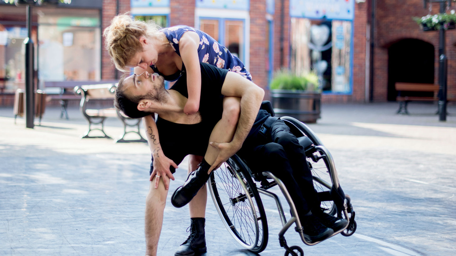 A photo of a man on a wheelchair and a woman dancing during the Liberty Festival.