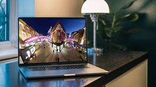A virtual tour of Carnaby Christmas lights playing on a laptop which sits on a table with a window in the background.