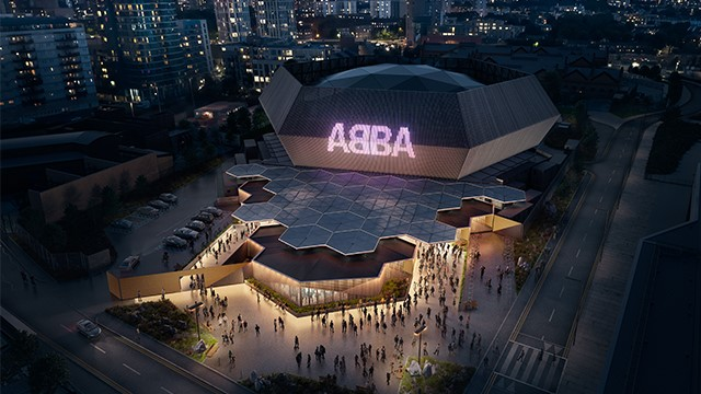 Image of ABBA Arena at Queen Elizabeth Olympic Stadium with London skyline at night. Image courtesy of Alan Schaller.