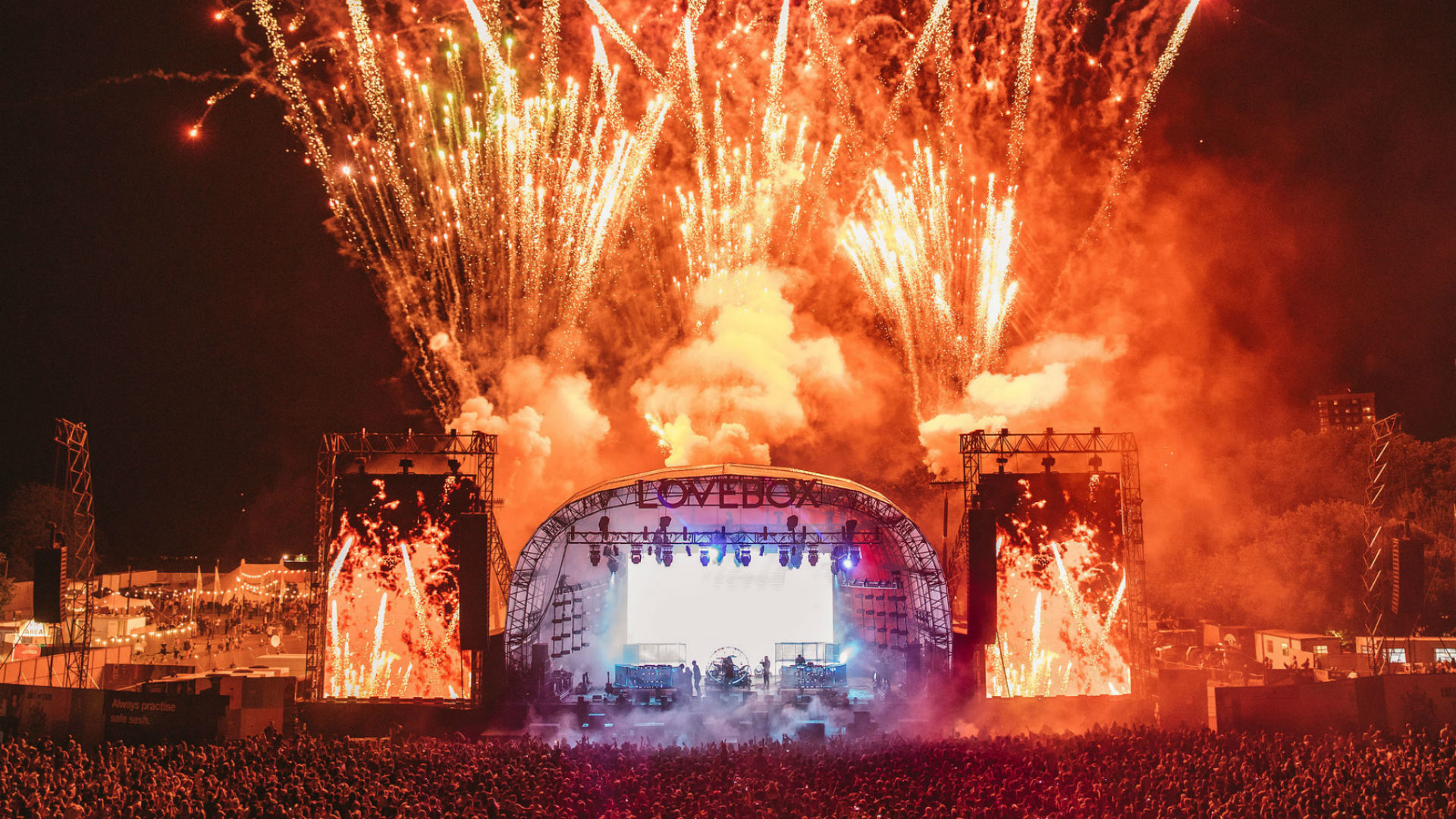 Image of fireworks lighting up the sky surrounding the stage at Lovebox.