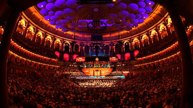The Royal Albert Hall with people sitting around the main stage during BBC Proms.